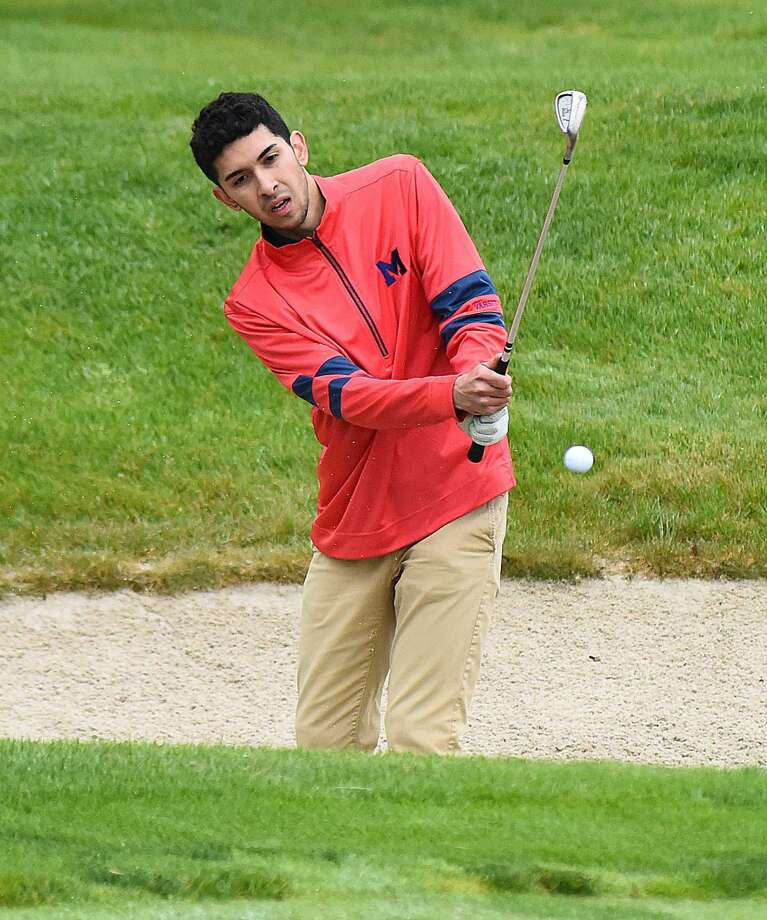Emmanuel Valdivinos of Brien McMahon holes out his bunker shot on the sixth hole at Shorehaven on Tuesday.