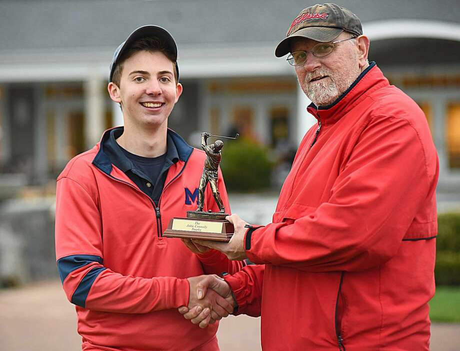 Brien McMahon's Jake Berkowitz, left, shakes hands with Senators head coach Bo Kane on Tuesday after winning the John Connolly Trophy for the low score in the annual Norwalk-McMahon golf match. The Bears won the Courville Cup with a 213-235 win over Brien McMahon at the Shorehaven Golf Club in Norwalk.