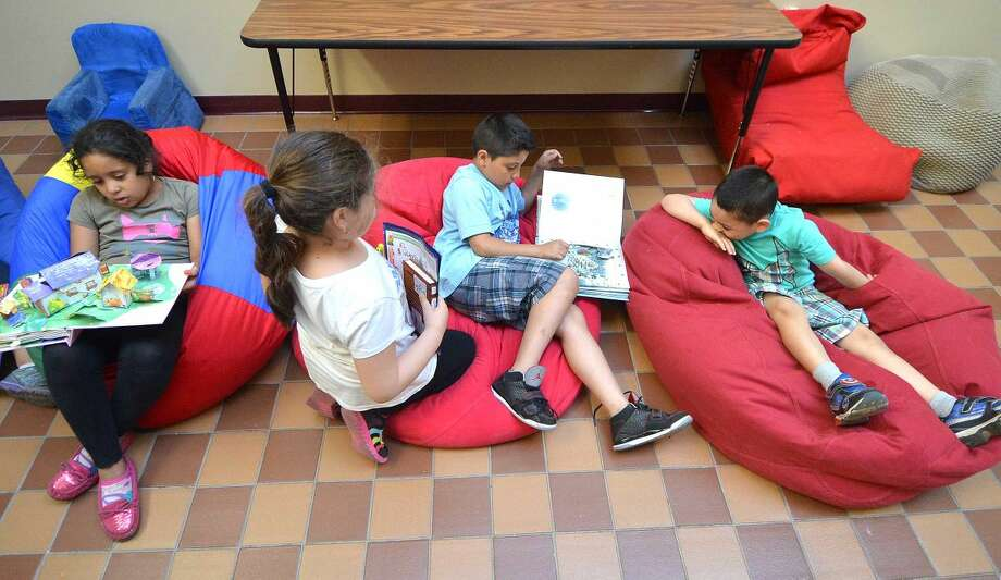 Hour Photo/Alex von Kleydorff Time to read a good book during the After the Bell program at SoNo Community Center