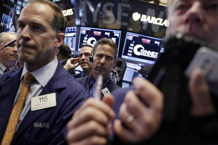 Traders gather at a post on the floor of the New York Stock Exchange Thursday, May 7, 2015. U.S. stocks are opening mostly lower, pushing the Dow Jones industrial average into the red for the year. (AP Photo/Richard Drew)