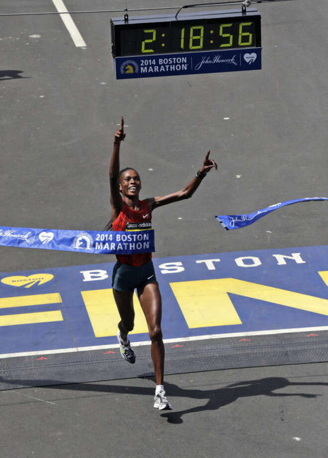 Rita Jeptoo, of Kenya, breaks the tape to win the women's division of the 118th Boston Marathon Monday, April 21, 2014 in Boston. (AP Photo/Charles Krupa)