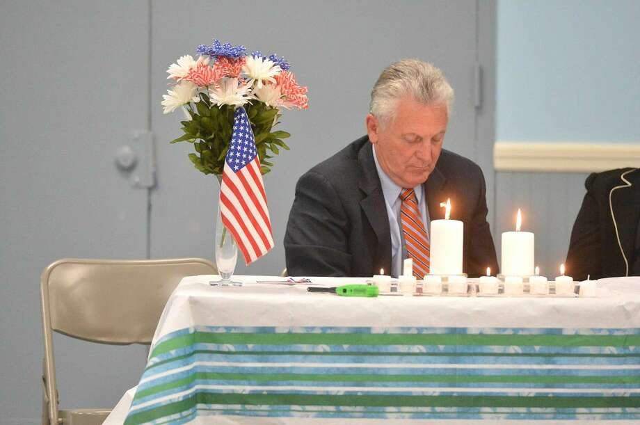 Hour Photo/Alex von Kleydorff Mayor Harry Rilling during a moment of silence during the observance of the National Day of Prayer at a service at the SoNo Community Center Thursday
