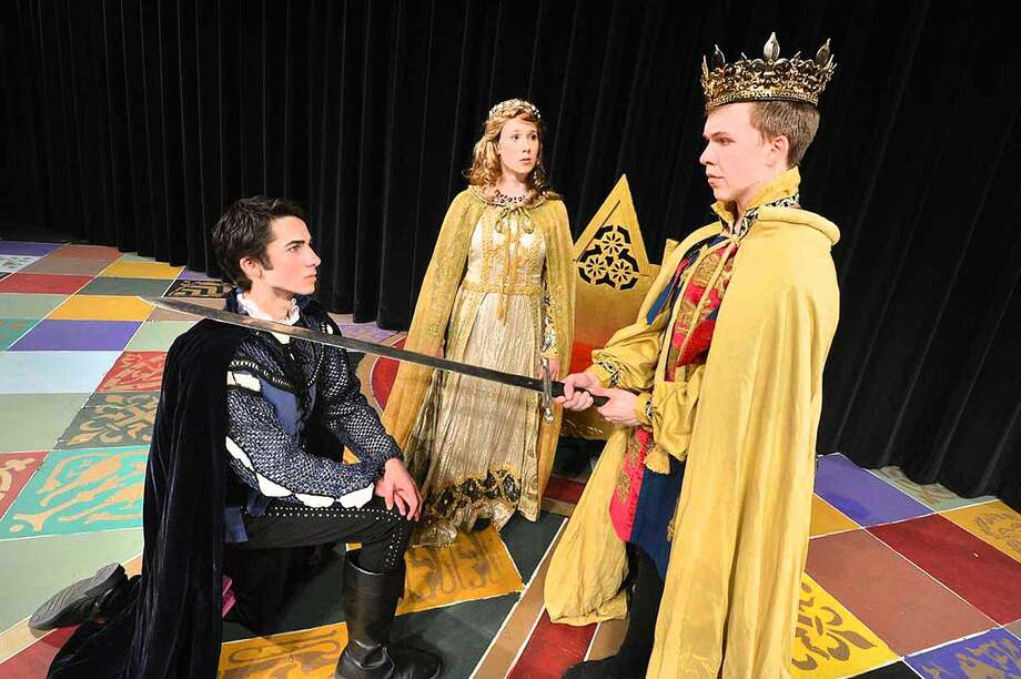 Hour Photo/Alex von Kleydorff King Arthur (Griffin King) invests Lancelot (Daniel Glynn) with Knighthood in the Round Table as Guinevere (Caitlin Witty) looks on
