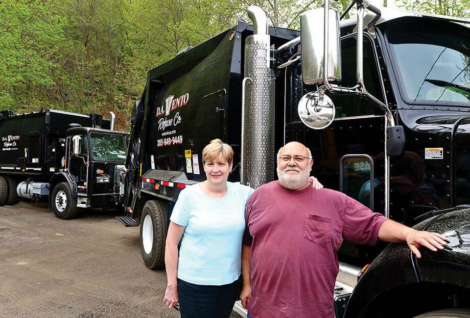 Darlene and Domincik Vento, with one of their new, re-purposed multi-stream recycling trucks.