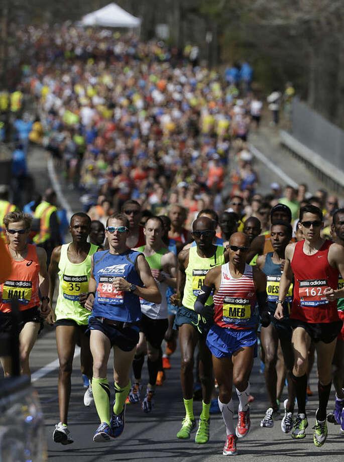 The elite men's runners compete near the start of the 118th Boston Marathon Monday, April 21, 2014 in Hopkinton, Mass. (AP Photo/Steven Senne)