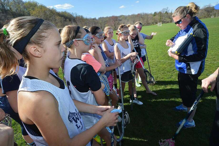 Coach Joanne Lussier works with the 7A travel girls lacrosse team in Wilton, all are wearing the Triax Sensor.