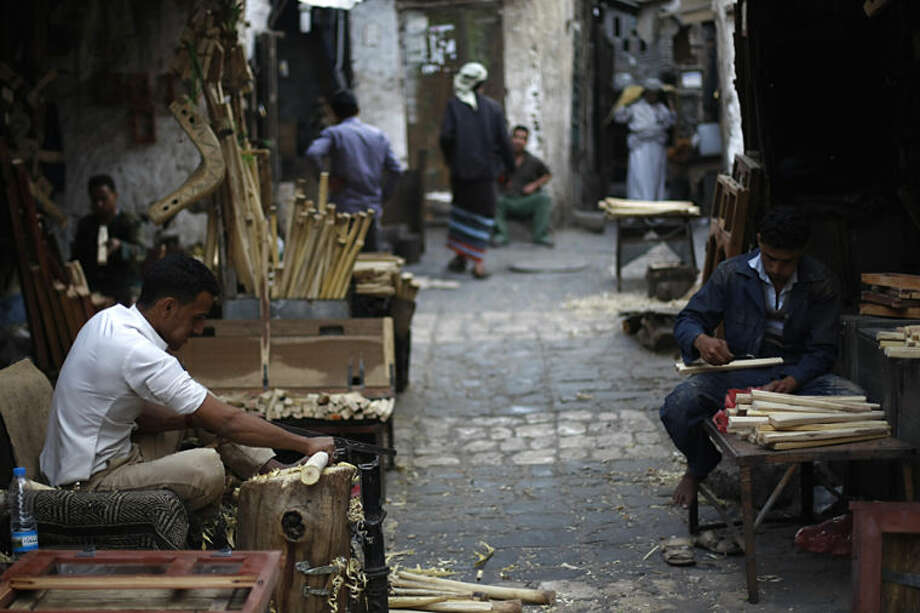 Yemeni men work in their shop making agricultural tools, at a marketplace in the old city of Sanaa, Yemen, Monday, April 21, 2014. (AP Photo/Hani Mohammed)