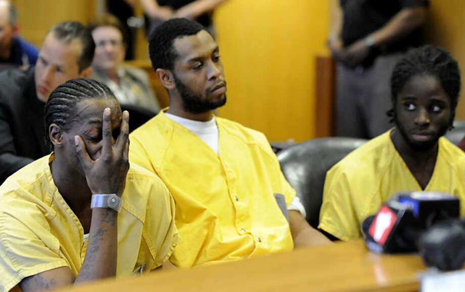 Defendants Wonzey Saffold, left, James Davis, center, and Latrez Cummings sit before Judge Thomas Jackson, at Frank Murphy Hall of Justice, Monday, April 21, 2014, in Detroit. The three men, and one other, were accused of punching and kicking motorist, Steve Utash, who accidentally struck a 10-year-old Detroit boy. The men were ordered Monday to stand trial on attempted murder charges. (AP Photo/Detroit News, David Coates) DETROIT FREE PRESS OUT; HUFFINGTON POST OUT