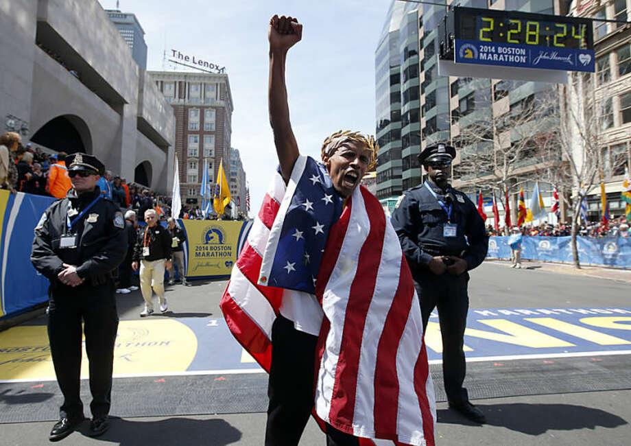 Meb Keflezighi, of San Diego, Calif., celebrates his victory in the 118th Boston Marathon, Monday, April 21, 2014, in Boston. (AP Photo/Elise Amendola)