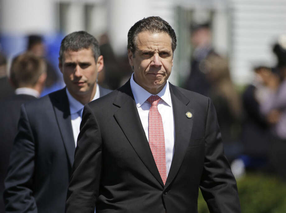 New York Gov. Andrew Cuomo leaves the wake for New York City police officer Brian Moore Thursday, May 7, 2015, in Bethpage, N.Y. Moore died Monday after being shot in the head while on duty last Saturday. The 25-year-old and his partner had stopped a man suspected of carrying a handgun when the man opened fire on them. (AP Photo/Seth Wenig)
