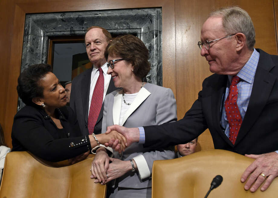 Attorney General Loretta Lynch shakes hands with Senate subcommittee on Commerce, Justice, Science, and Related Agencies member Sen. Lamar Alexander, R-Tenn., right, accompanied by subcommittee Chairman Sen. Richard Shelby, R-Ala., second from left, and Sen. Susan Collins, R-Maine, as she arrives on Capitol Hill in Washington, Thursday, May 7, 2015, to testify before the subcommittee's hearing to examine the proposed budget estimates for fiscal year 2016 for the Justice Department. (AP Photo/Susan Walsh)