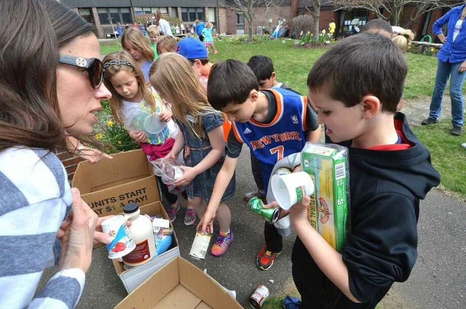 Hour Photo/Alex von Kleydorff First graders at Miller Driscoll School learn about recycling during Earth day at The Outdoor learning Center at the school