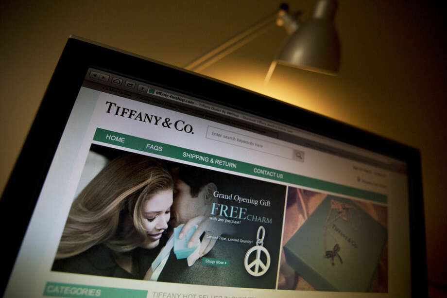 This Saturday, April 11, 2015 photo shows a counterfeit Tiffany & Co., website on a computer monitor in Beijing. In 2014, Tiffany sued to shut at least 199 new counterfeiting websites, but another generation of copycats has already sprung up. (AP Photo/Ng Han Guan)