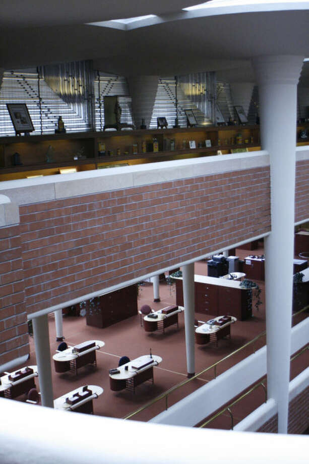 This Friday, April 18, 2014, photo shows the view from the upper level into the great room of the SC Johnson Administration Building in Racine, Wis. The building was designed by famed architect Frank Lloyd Wright. (AP Photo/M.L. Johnson)