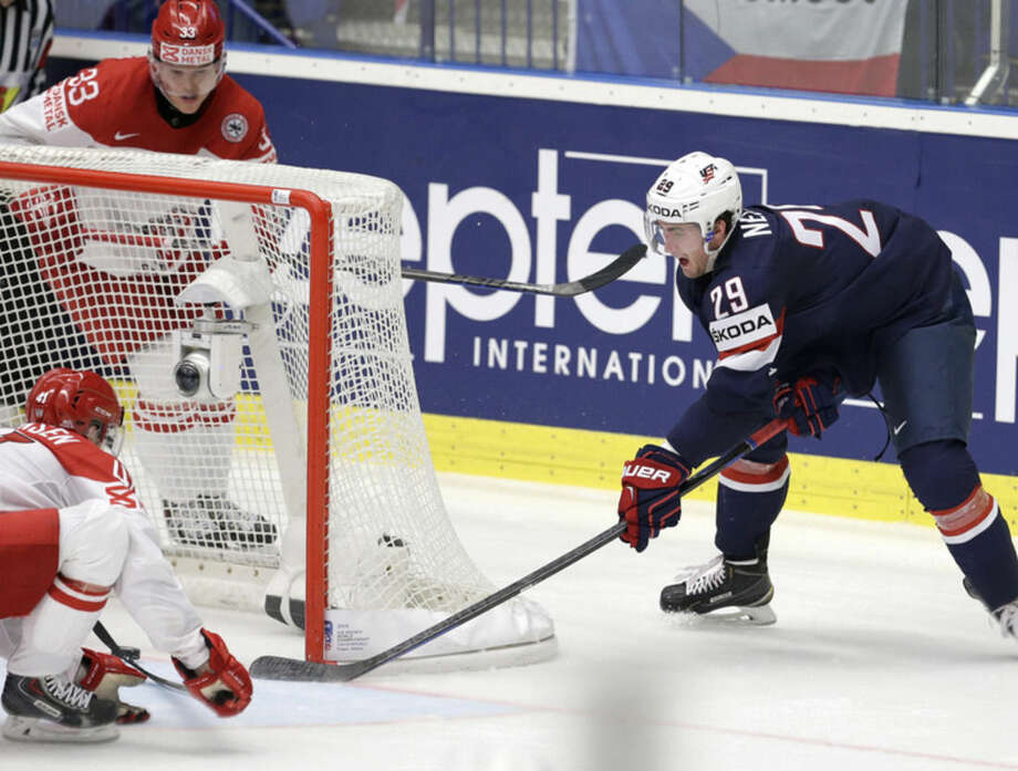 Brock Nelson of USA, right, scores the opening coal against Denmark during a Hockey World Championships Group B match in Ostrava, Czech Republic, Friday, May 8, 2015. (AP Photo/Sergei Grits)