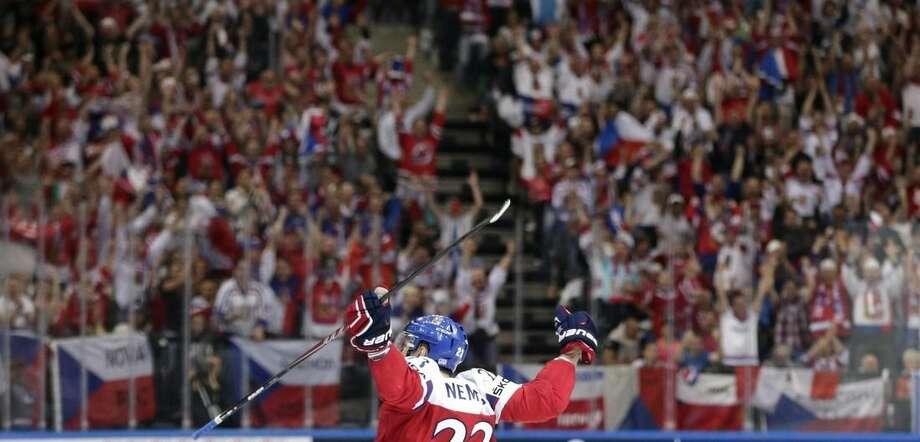 Czech Republic's Ondrej Nemec scoring against Austria during the Hockey World Championships Group A match in Prague, Czech Republic, Friday, May 8, 2015. (AP Photo/Petr David Josek)