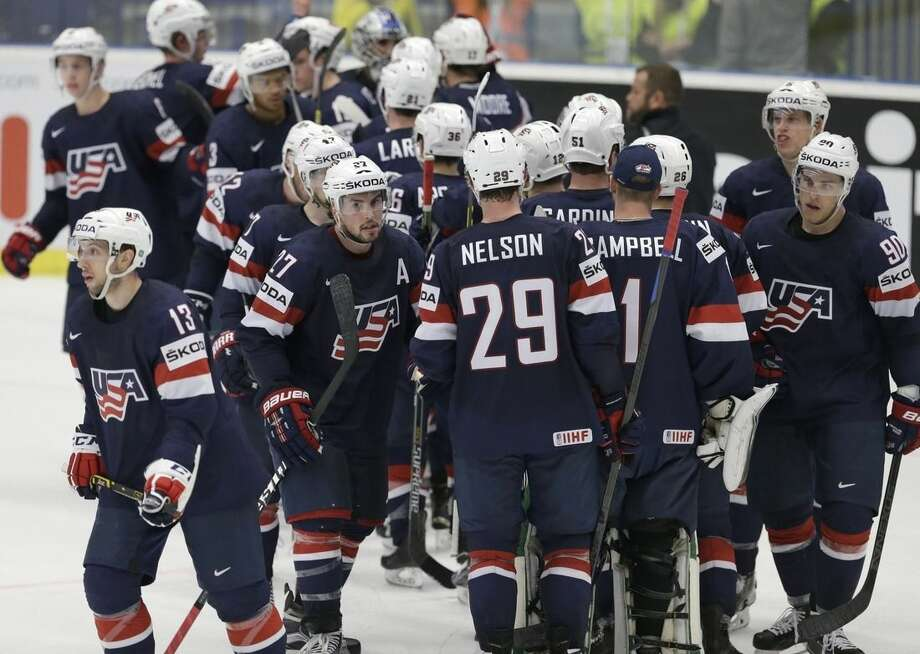 USA players celebrate their victory during the Hockey World Championships Group B match against Denmark in Ostrava, Czech Republic, Friday, May 8, 2015. (AP Photo/Sergei Grits)