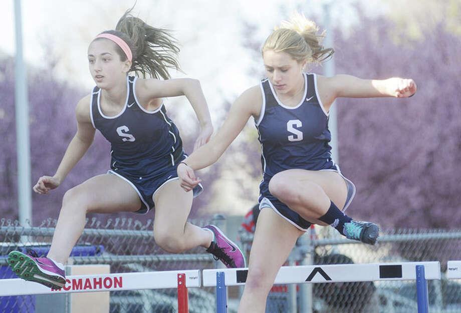 Staples girls track and field, Anna Daytz and Michelle Partner 100 meter hurdles. Hour photo/Matthew Vinci