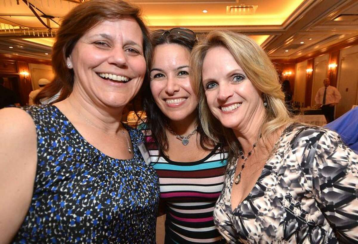 Hour Photo/Alex von Kleydorff Susan Zecca Anita Oehley and Shelly Welch share a laugh at the Silent Auction and Wine Tasting to benefit the PAL, Police Athletic League program at the Norwalk Police Department