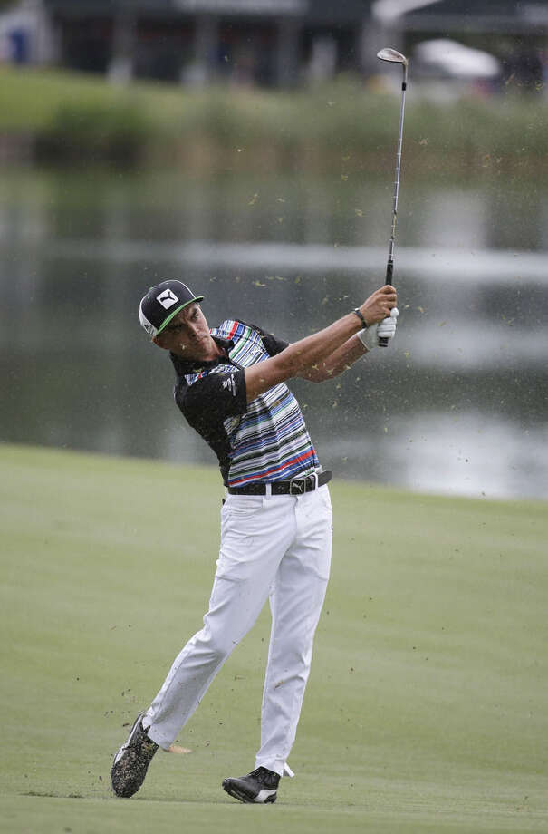 Rickie Fowler hits from the 18th fairway during the second round of The Players Championship golf tournament Friday, May 8, 2015, in Ponte Vedra Beach, Fla. (AP Photo/Lynne Sladky)