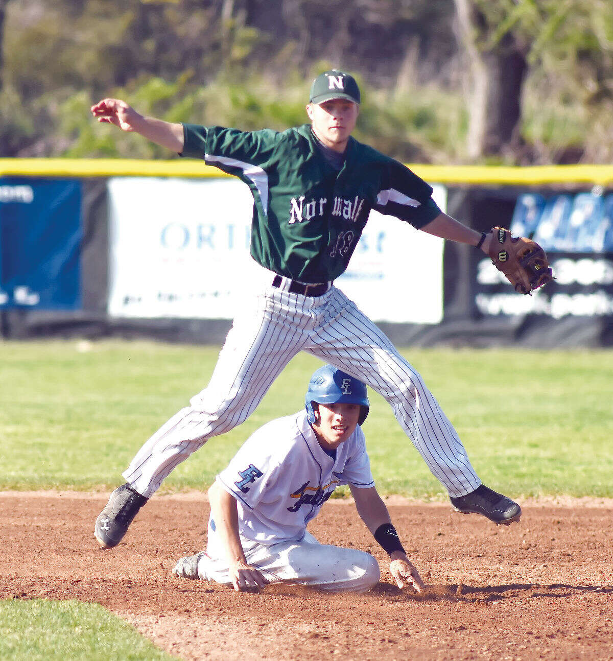 Hour photo/John Nash - Norwalk second baseman David Balunek, top, watches his throw to first as the Bears turned a double play against Fairfield Ludlowe on Friday.