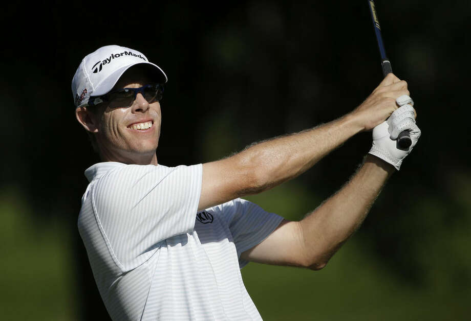 David Hearn, of Canada, watches his shot from the eighth tee during the second round of The Players Championship golf tournament Friday, May 8, 2015, in Ponte Vedra Beach, Fla. (AP Photo/Chris O'Meara)