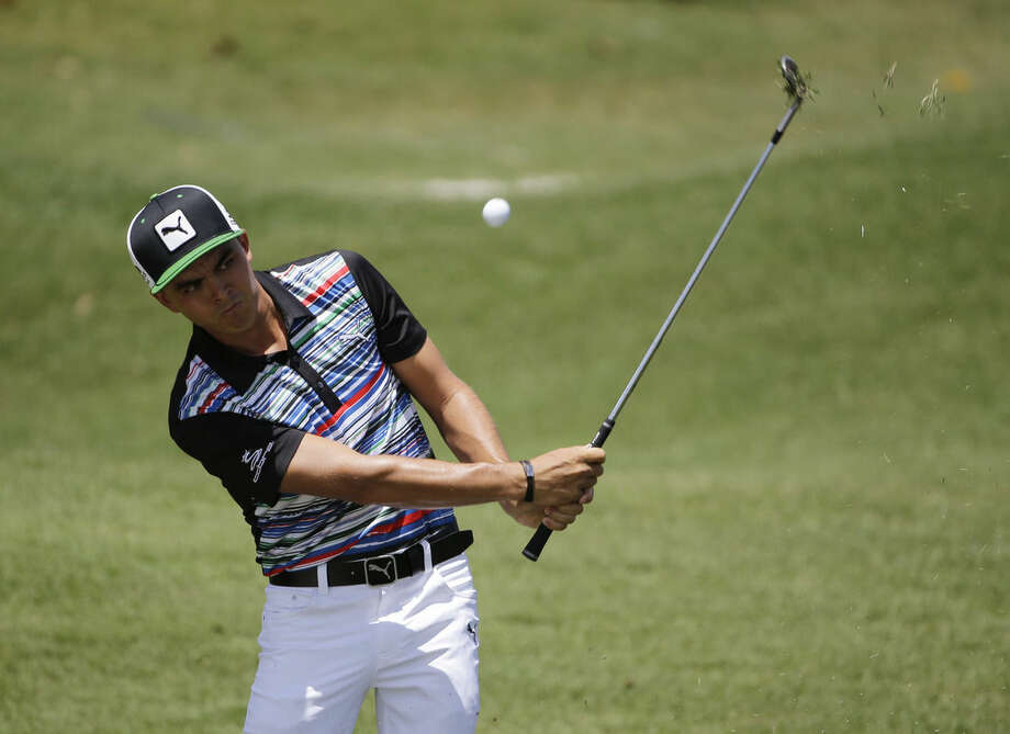 Rickie Fowler hits on the second hole during the second round of The Players Championship golf tournament Friday, May 8, 2015, in Ponte Vedra Beach, Fla. (AP Photo/Chris O'Meara)