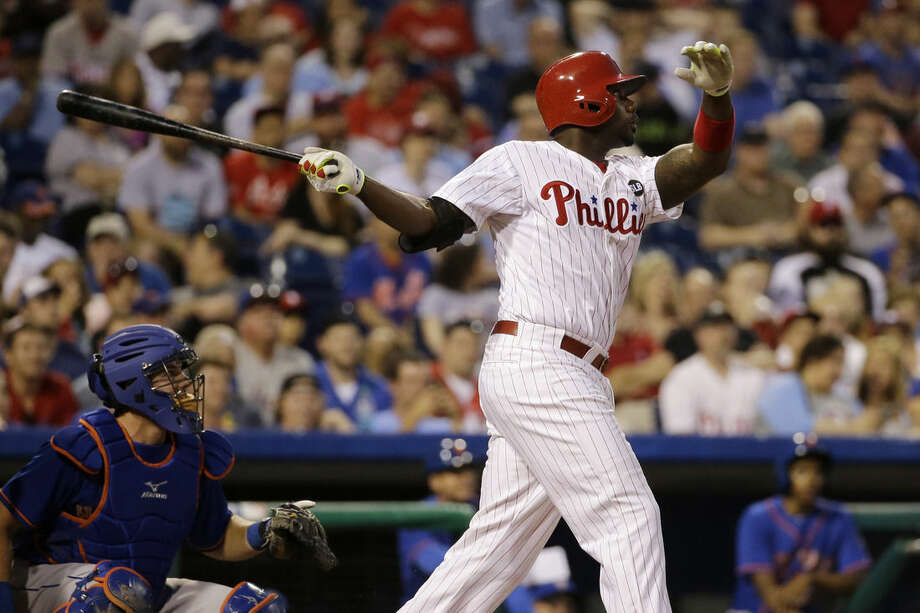 Philadelphia Phillies' Ryan Howard, right, follows through after hitting a home run off New York Mets starting pitcher Matt Harvey during the fourth inning of a baseball game, Friday, May 8, 2015, in Philadelphia. Mets catcher Kevin Plawecki, left, looks on. (AP Photo/Matt Slocum)