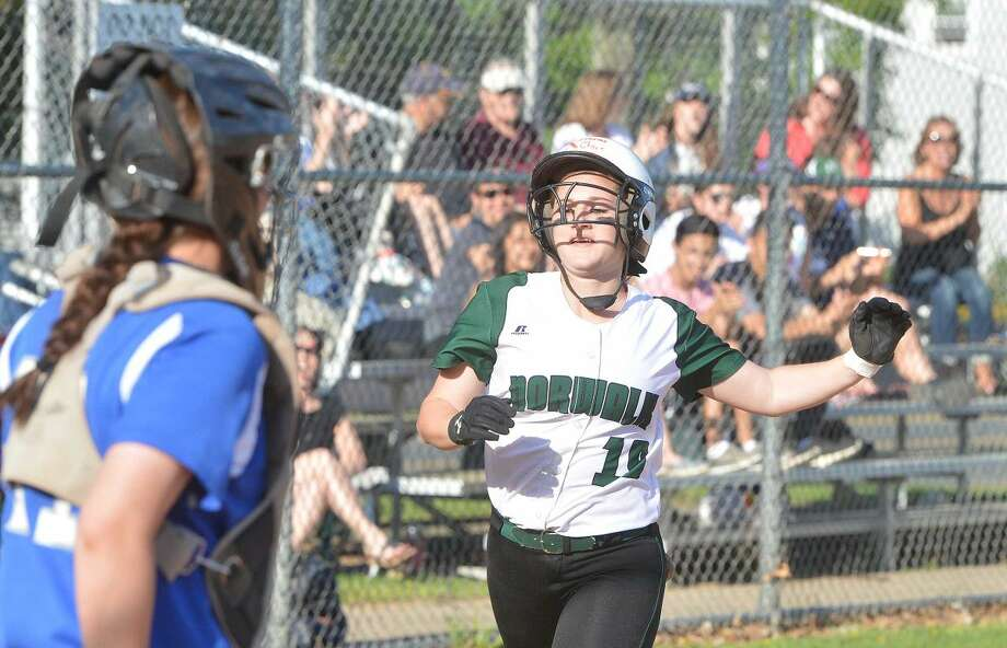 Hour Photo/Alex von Kleydorff Norwalks #19 Samantha Troetti heads for home after hitting a home run vs Ludlowe