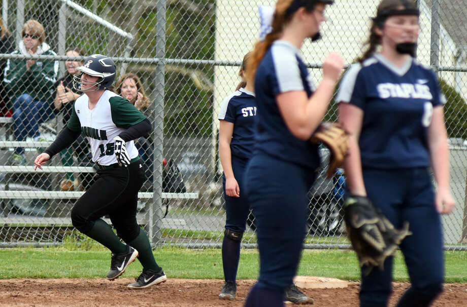 Dina DeBlasio, left, rounds the bases after a home run during action from Monday's FCIAC Softball game between Staples and Norwalk. Staples won the game, 9-8.