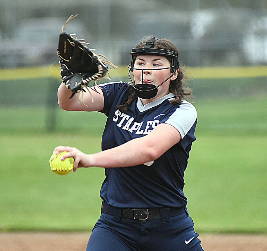 Staples relief pitcher Cat Connell, a freshman, rears back and fires to the plate during Monday's FCIAC softball game against Norwalk. Connell entered the game in bottom of the fifth and earned the save in Staples' 9-8 win.