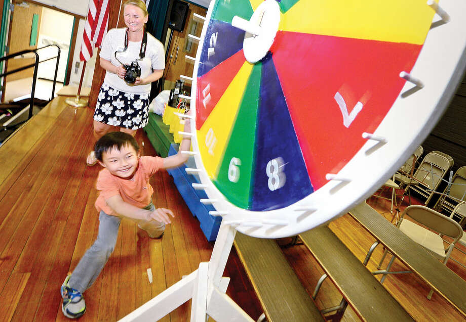 Hour photo / Erik TrautmannRowayton Elementary School first grader Brian Fogerty spins the wheel for a prize as part of Hype Week in advance of the school's acrnival this weekend.
