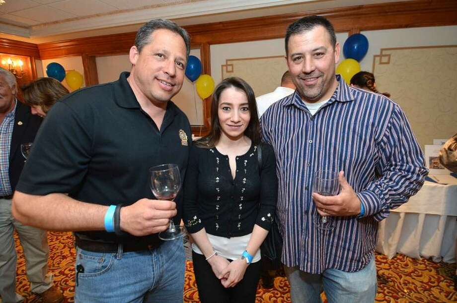 Hour Photo/Alex von Kleydorff Sal Calise, Elvira Funicello and Marc Lepore at the Silent Auction and Wine Tasting to benefit the PAL, Police Athletic League program at the Norwalk Police Department