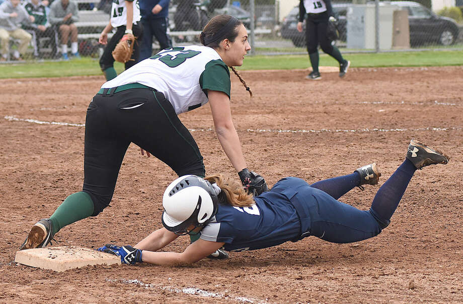 Norwalk first baseman Jessica Giglio, left, forces out Staples baserunner Lillly Tofel on the back end of a double play during Monday's FCIAC softball game in Norwalk. Staples won the game, 9-8.