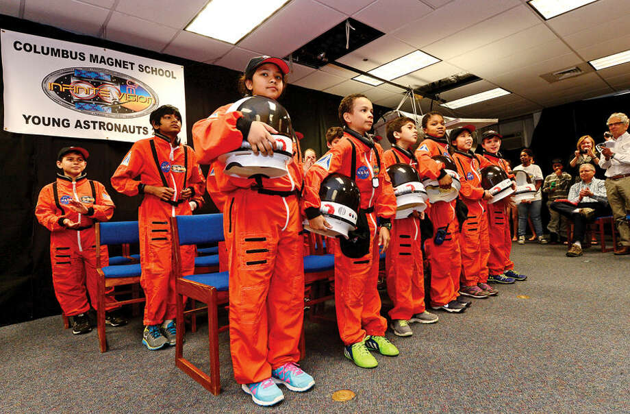 Hour photo / Erik Trautmann Partcipants in the Young Astronauts program at Columbus Magnet School celebrate the landing of their latest mission, Infinite Vision, and the programs 20th anniversay Friday morning at the school.