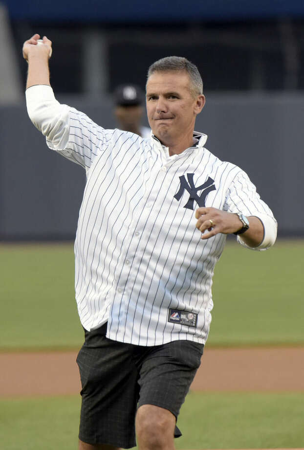 Ohio State football coach Urban Meyer throws out the ceremonial first pitch before the New York Yankees play against the Baltimore Orioles in a baseball game Friday, May 8, 2015, at Yankee Stadium in New York. (AP Photo/Bill Kostroun)