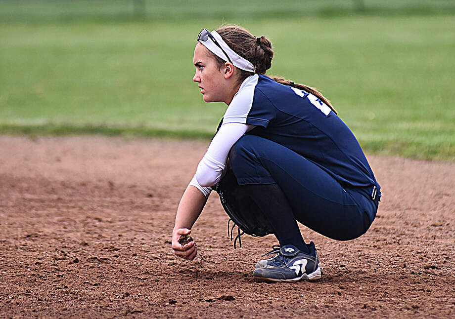 Staples Taylor Rochlin passes the time at second base during a timeout in Monday's FCIAC Softball game against Norwalk. Staples won the game, 9-8.