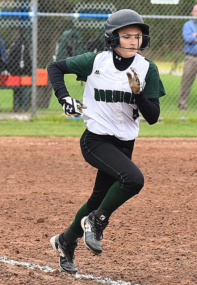 Action from Monday's FCIAC Softball game between Staples and Norwalk. Staples won the game, 9-8.