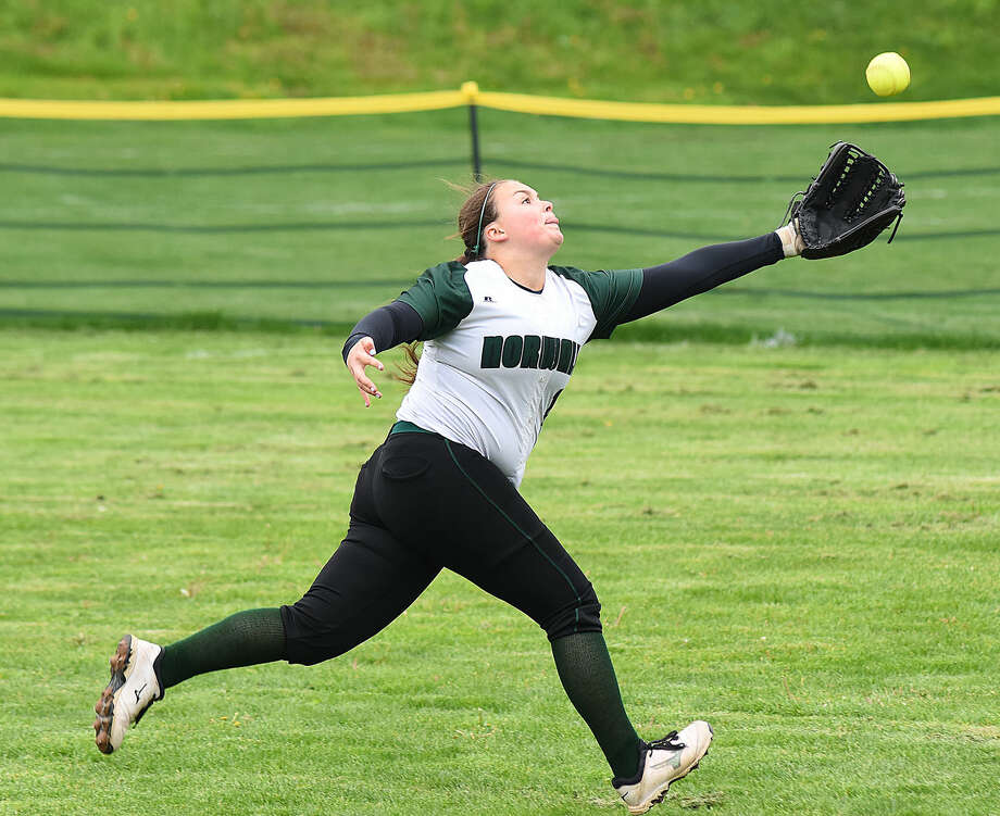 Norwalk right fielder Allli Pitasi extends in a vain attempt to track down a long fly ball during Monday's FCIAC softball game against Staples at Red Barry Field in Norwalk. Staples won the game, 9-8.