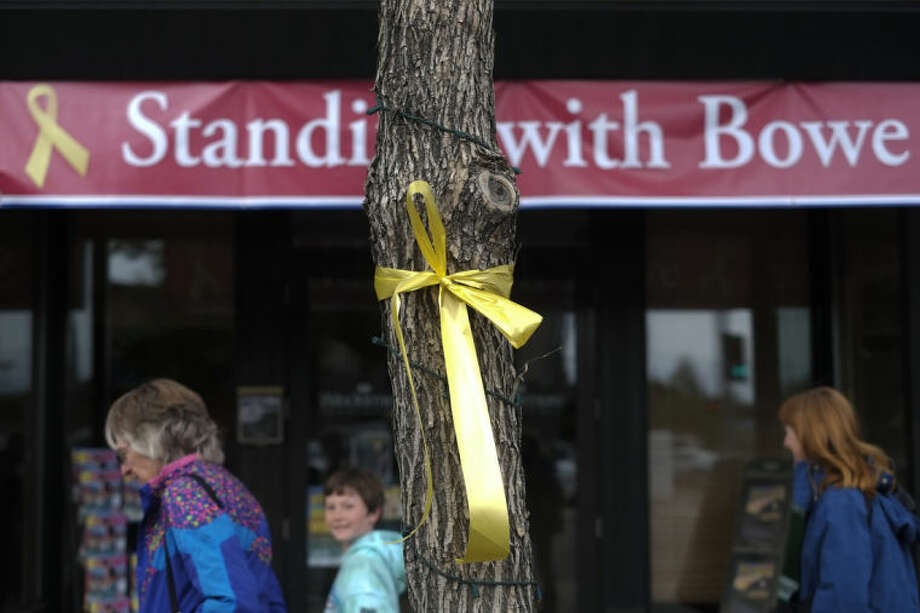 FILE - This June 21, 2013 file photo shows a yellow ribbon honoring captive U.S. Army Sgt. Bowe Bergdahl tied to a tree in Hailey, Idaho. The nearly five-year effort to free the only American soldier held captive in Afghanistan is scattered among numerous federal agencies with a loosely organized group of people working on it mostly part time, according to two members of Congress and military officials involved in the effort. An ever-shrinking U.S. military presence in Afghanistan has re-focused attention on efforts to bring home Bergdahl, who has been held by the Taliban since June 30, 2009. (AP Photo/Jae C. Hong, File)