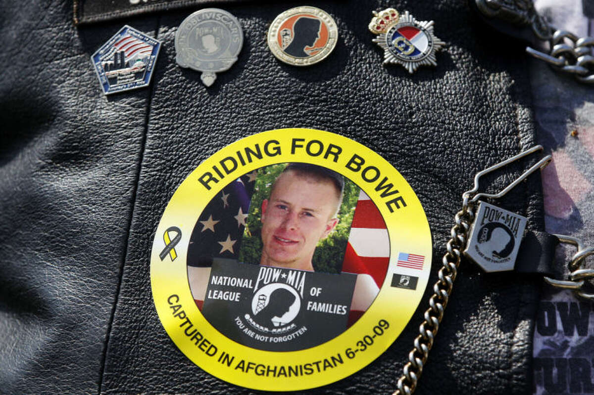 FILE -- The May 27, 2012 file photo shows an image of Army Sgt. Bowe Bergdahl of Hailey, Idaho, who is being held captive in Afghanistan, worn by an audience member as Bergdahl's father Bob spoke at the annual Rolling Thunder rally for POW/MIA awareness, in Washington. The nearly five-year effort to free the only American soldier held captive in Afghanistan is scattered among numerous federal agencies with a loosely organized group of people working on it mostly part time, according to two members of Congress and military officials involved in the effort. An ever-shrinking U.S. military presence in Afghanistan has re-focused attention on efforts to bring home Bergdahl, who has been held by the Taliban since June 30, 2009. (AP Photo/Charles Dharapak, File)