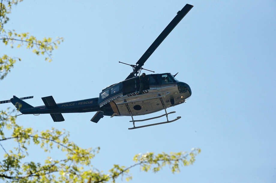 Hour photo / Erik Trautmann Ceremonial Flyover by Eagle 1 during the annual Norwalk Police Department Police Memorial Service Friday at police headquarters.