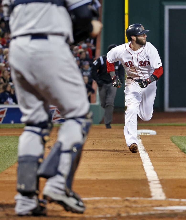 Boston Red Sox's Dustin Pedroia runs home to score on a single by A.J. Pierzynski in the first inning of a baseball game against the New York Yankees at Fenway Park in Boston, Wednesday, April 23, 2014. (AP Photo/Elise Amendola)
