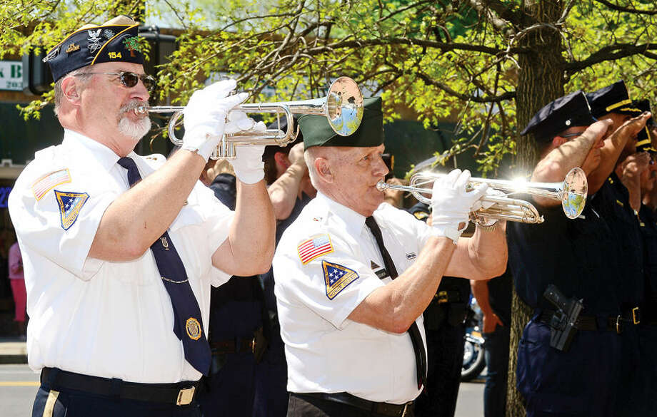 Hour photo / Erik Trautmann Jon Worley and Fred Miodowski play taps during the annual Norwalk Police Department Police Memorial Service Friday at police headquarters.