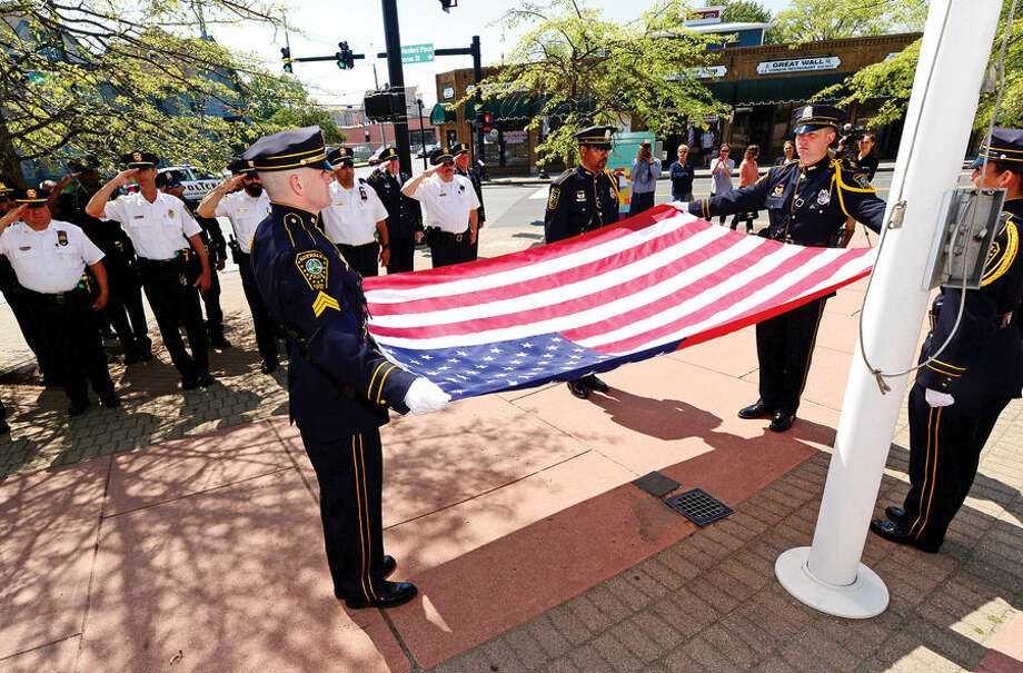 Hour photo / Erik Trautmann The Norwalk Police Honor Guard retire the colors during the annual Norwalk Police Department Police Memorial Service Friday at police headquarters.