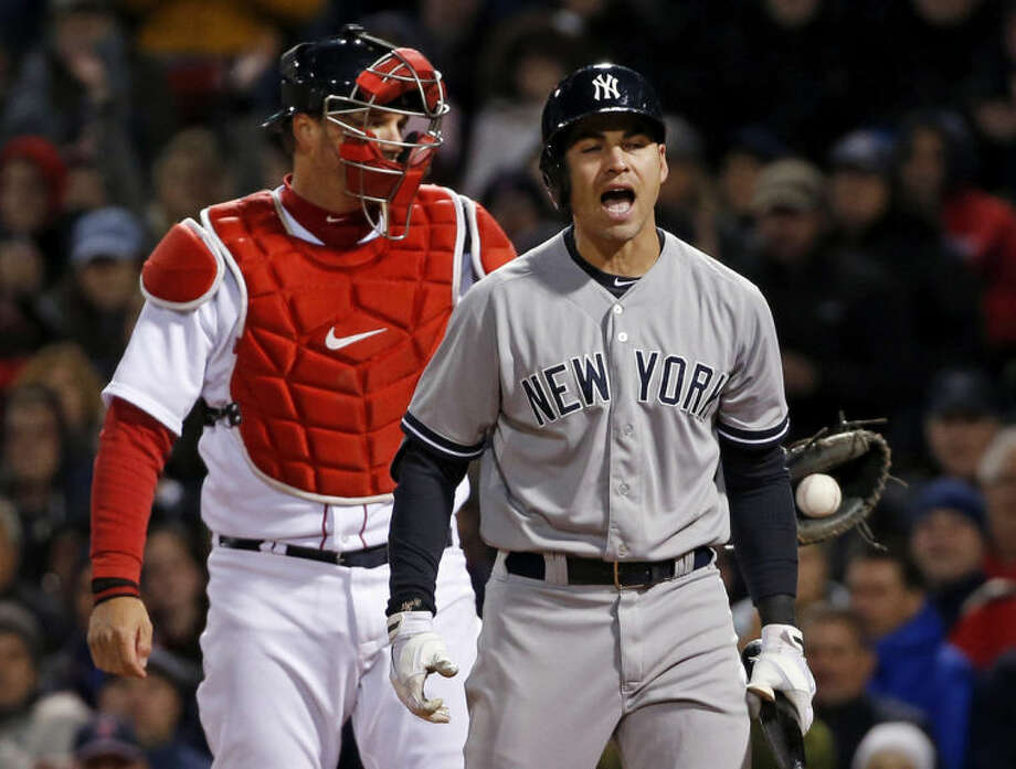 New York Yankees' Jacoby Ellsbury reacts after striking out as Boston Red Sox catcher A.J. Pierzynski holds the ball in the fifth inning of a baseball game at Fenway Park in Boston, Wednesday, April 23, 2014. (AP Photo/Elise Amendola)