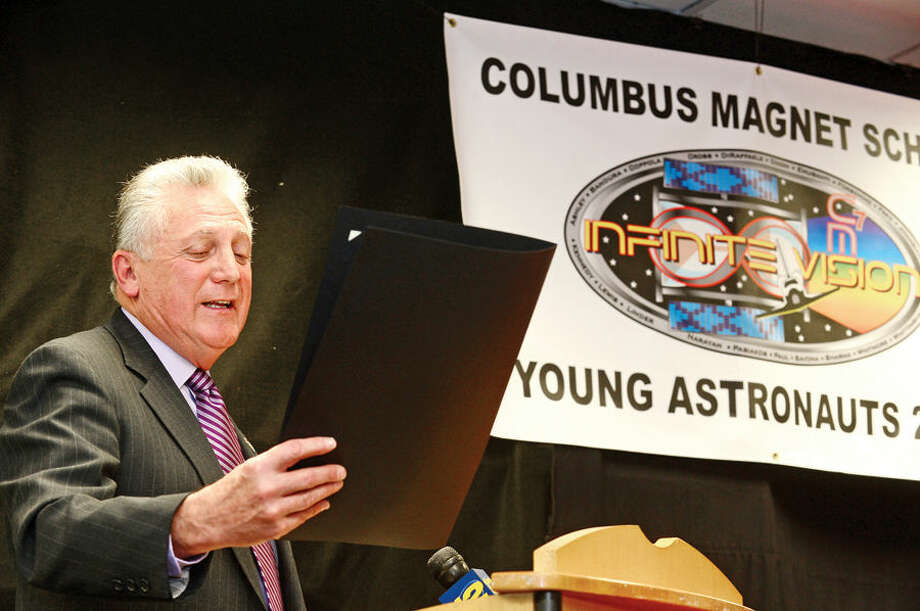 Hour photo / Erik Trautmann Norwalk mayor Harry Rilling reads a proclamation as the Young Astronauts program at Columbus Magnet School celebrates the landing of their latest mission, Infinite Vision, and the programs 20th anniversay Friday morning at the school.