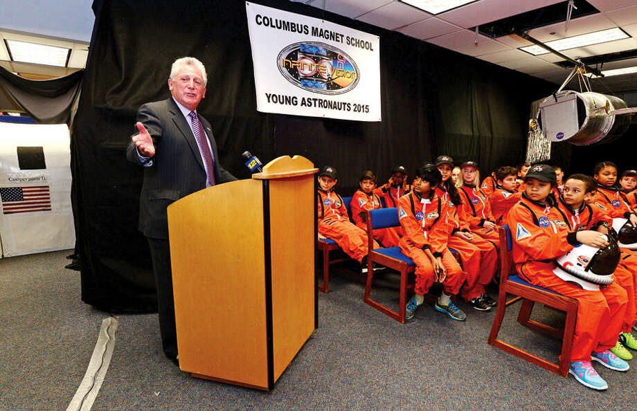 Hour photo / Erik Trautmann Norwalk mayor Harry Rilling congratulates the participating students as the Young Astronauts program at Columbus Magnet School celebrates the landing of their latest mission, Infinite Vision, and the programs 20th anniversay Friday morning at the school.
