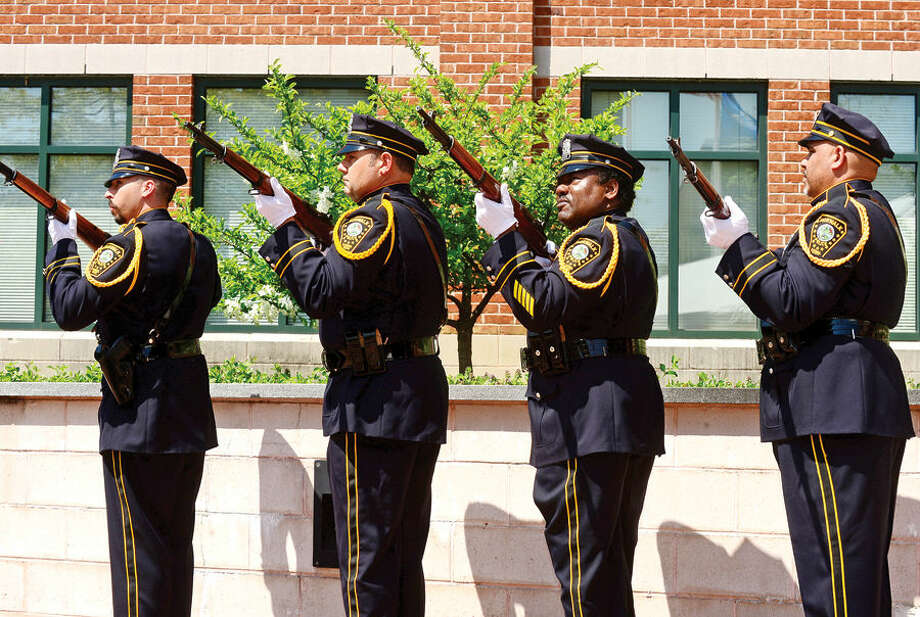Hour photo / Erik Trautmann The Norwalk Police DEaprtment Honor Guard fire a volley salute during the annual Norwalk Police Department Police Memorial Service Friday at police headquarters.