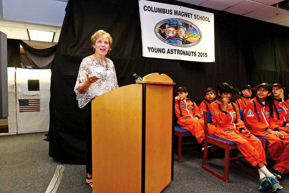 Hour photo / Erik Trautmann Former principla Marlyn Liberatore speaks as the Young Astronauts program at Columbus Magnet School celebrates the landing of their latest mission, Infinite Vision, and the programs 20th anniversay Friday morning at the school.